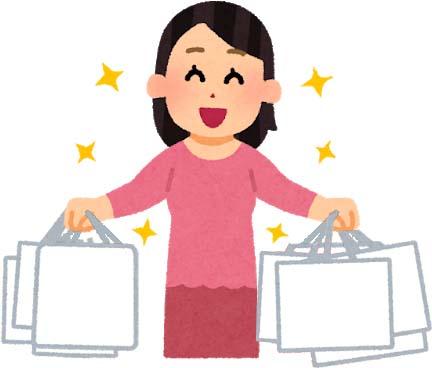 買い物袋をたくさん下げた女性